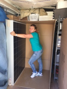 Darleen in the container with the solar panels