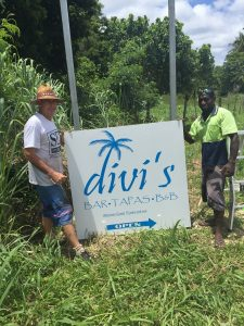 Josie & Scott erecting Divi sign