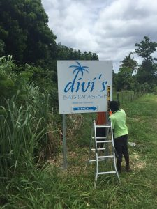 Josie erecting Divi sign